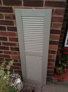 A uPVC shutter in Clay colour