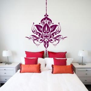 vinyl wall art above a bed
