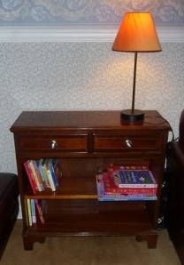Before makeover dark wood bookcase